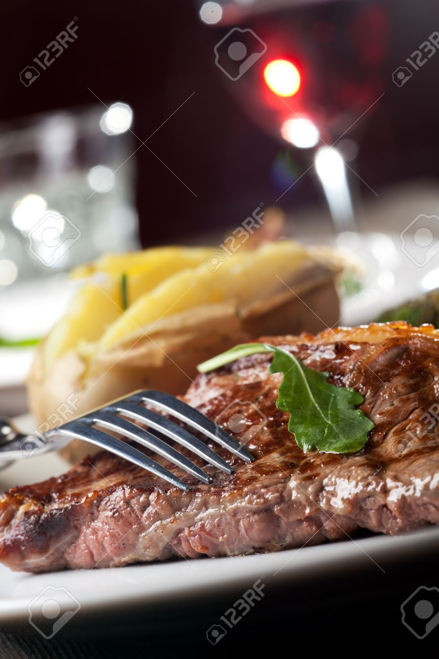 fork on a grilled steak Stock Photo - 13814070