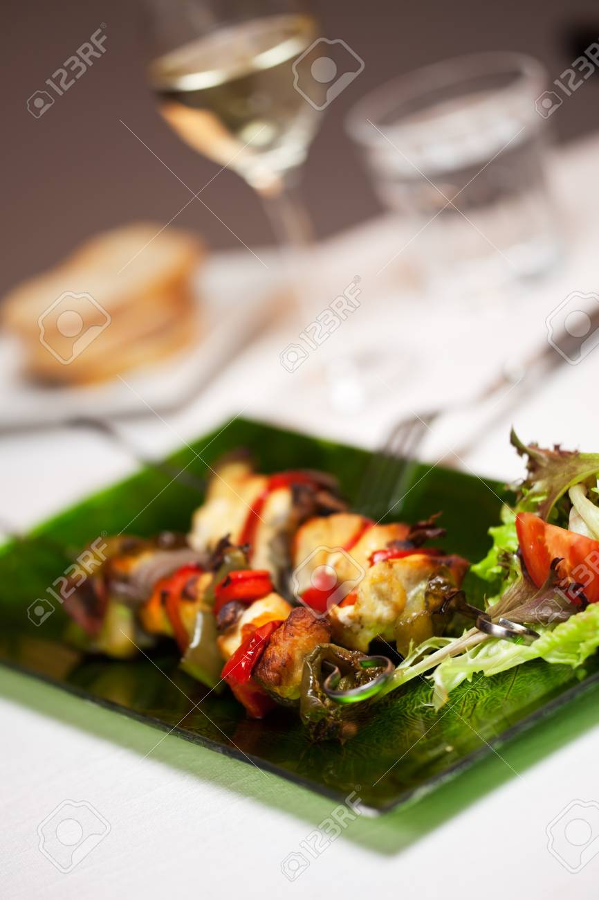chicken meat on skewers and salad Stock Photo - 14546330