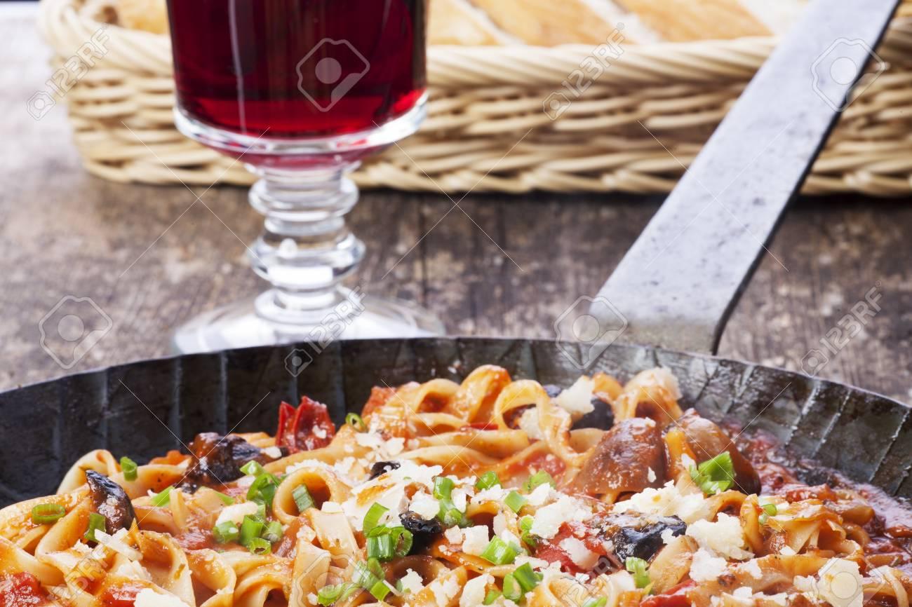 Mediterranean pasta dish in an iron pan Stock Photo - 16259581