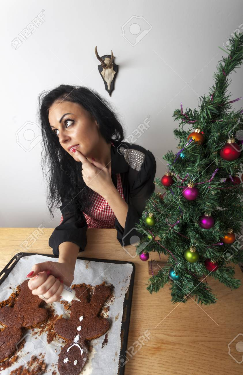 woman baking a gingerbread man Stock Photo - 17137003