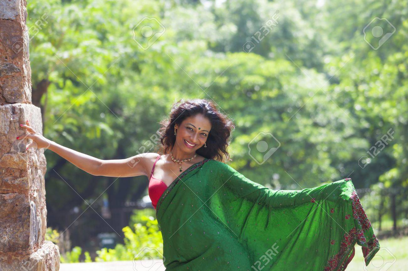 young indian woman in a saree outdoors Stock Photo - 17136999