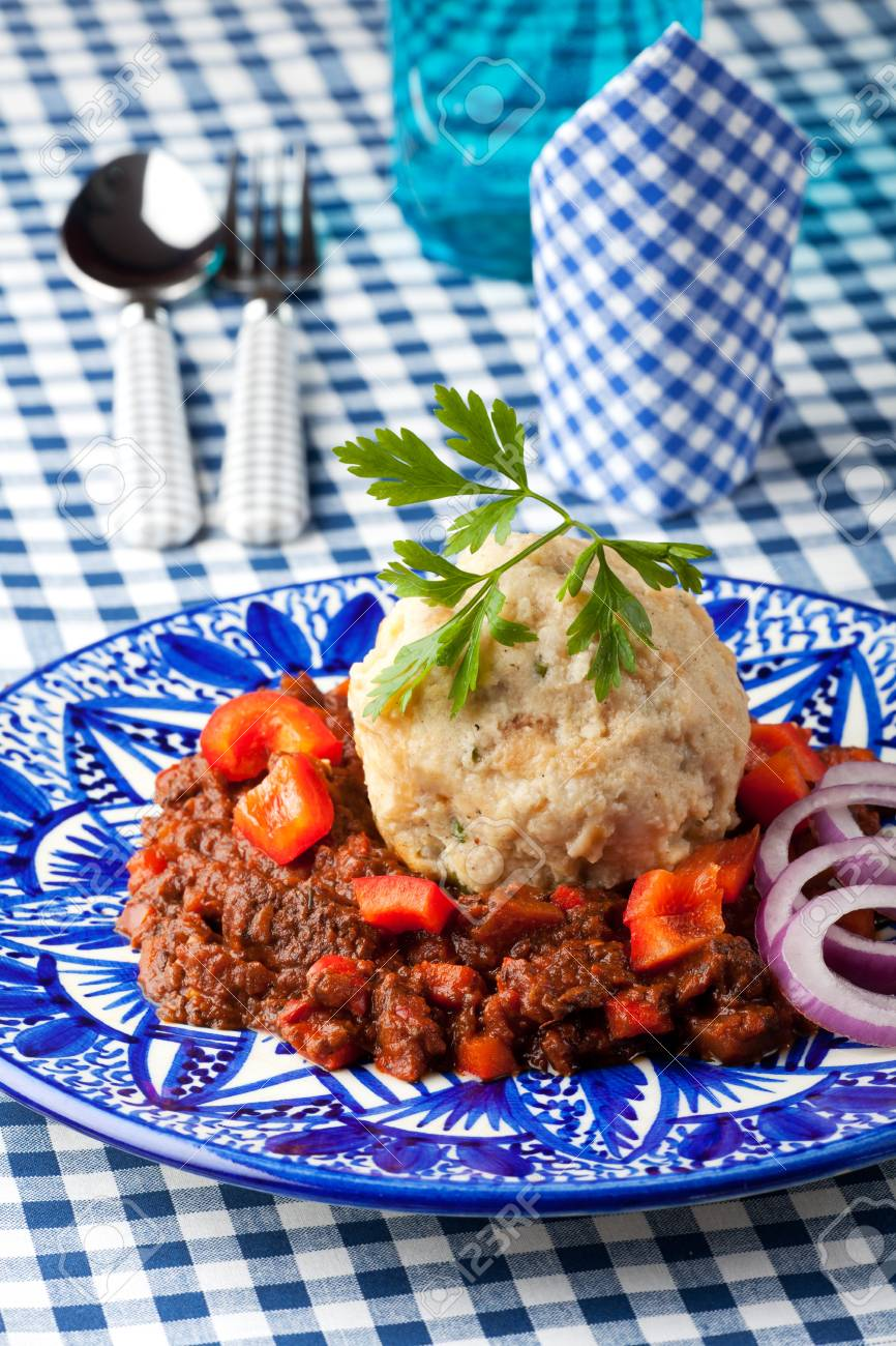goulash with dumpling on a blue plate Stock Photo - 17167646
