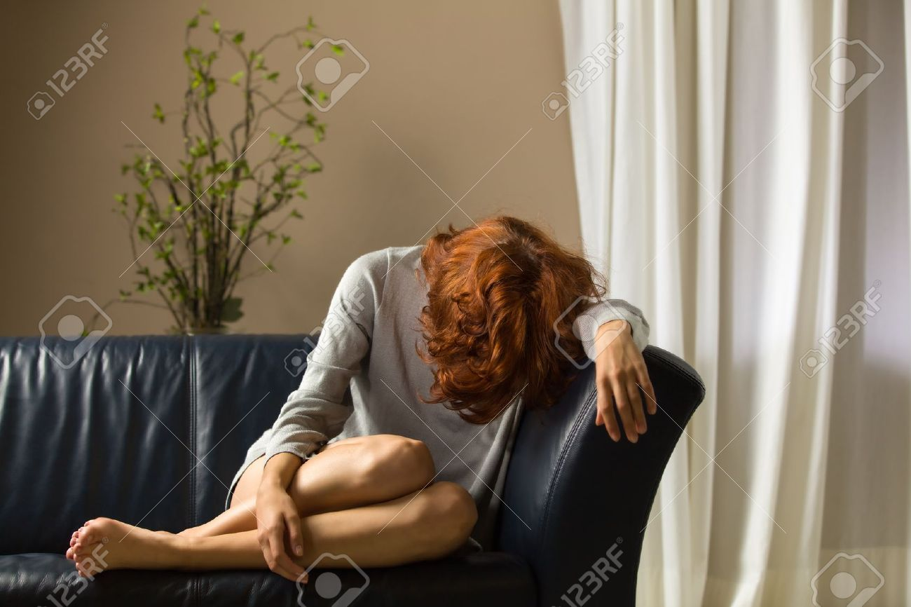 woman on a couch Stock Photo - 19201570