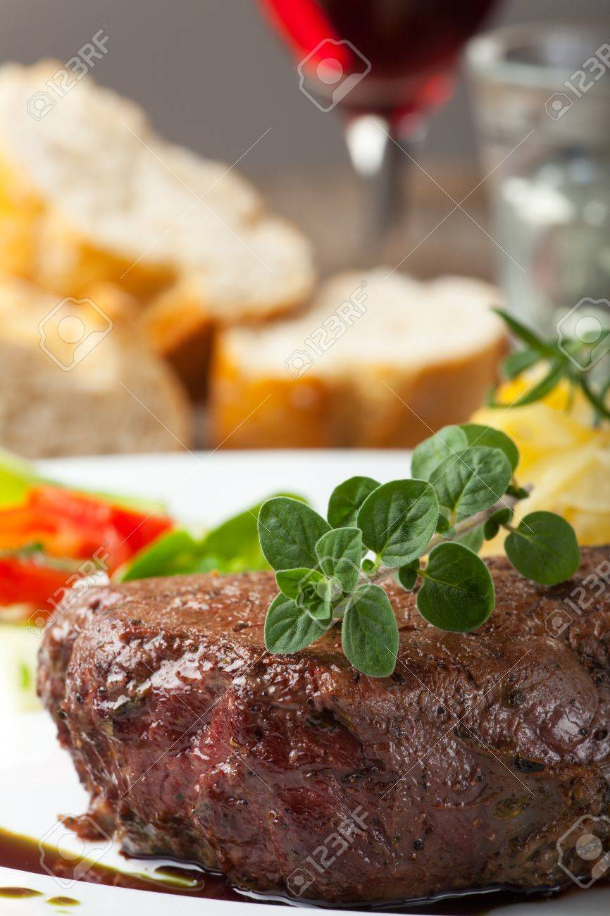 grilled steak with oregano Stock Photo - 20364417