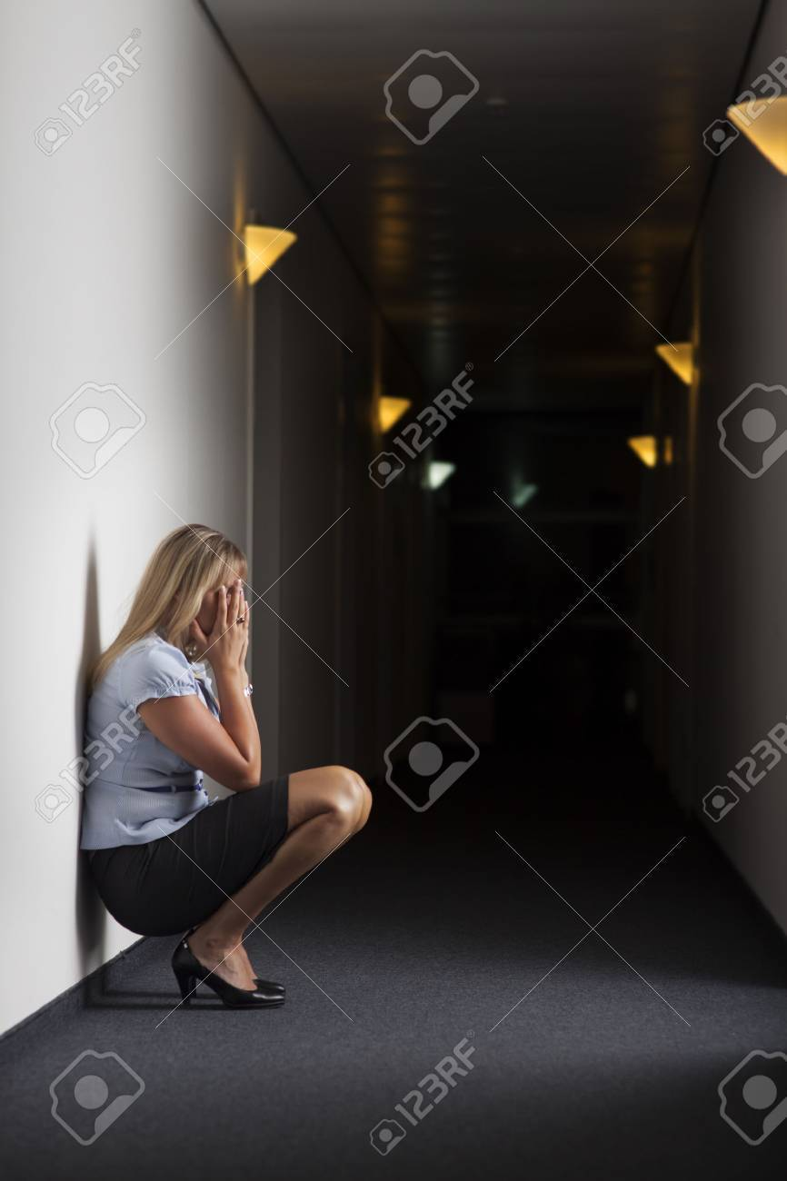 crying business woman in an office Stock Photo - 23776233