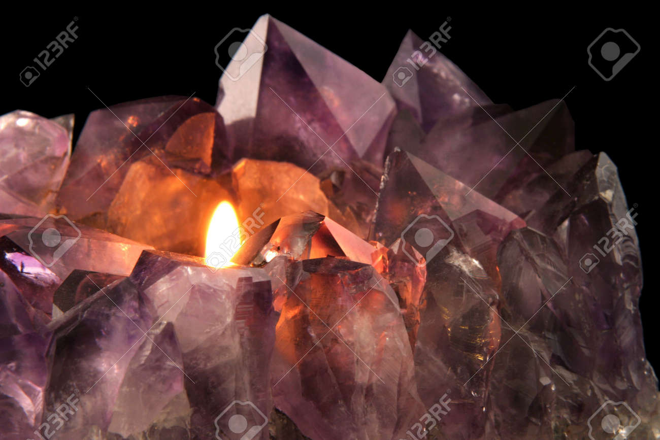 Amethyst Candlelight - Quartz crystal used in alternative medicine to alleviate stress and anxiety. Stock Photo - 891757