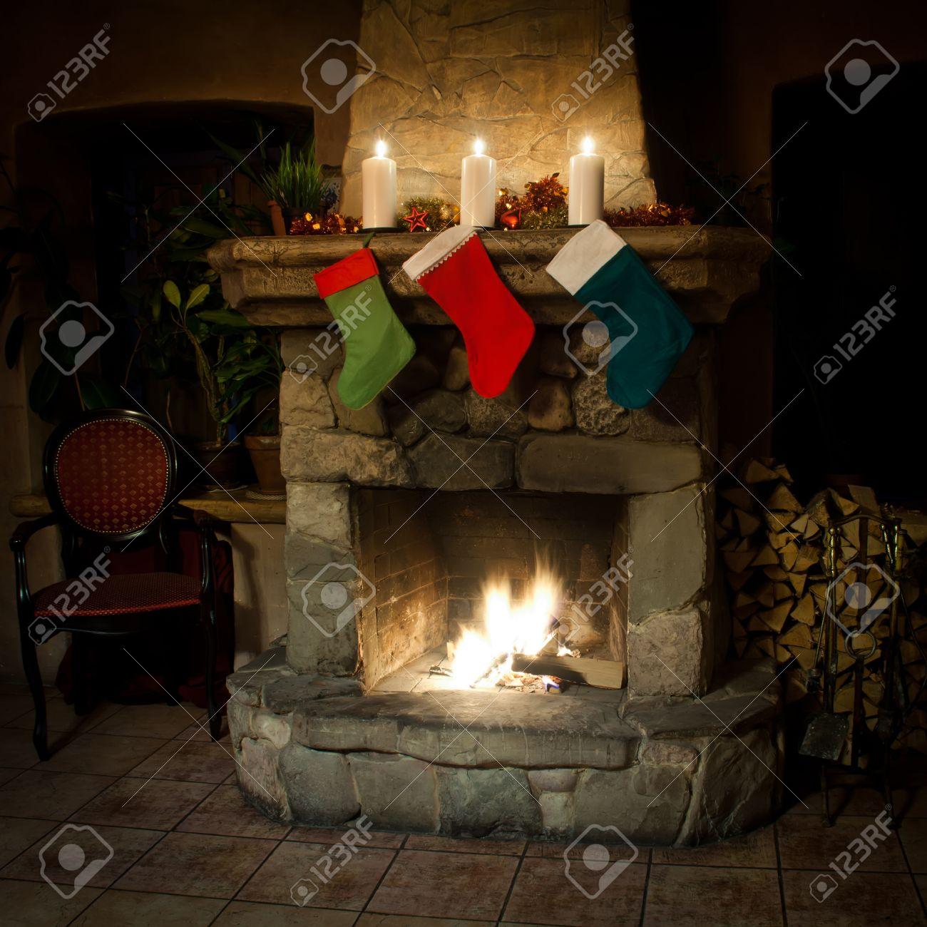 christmas stocking on fireplace background chimney candles stock