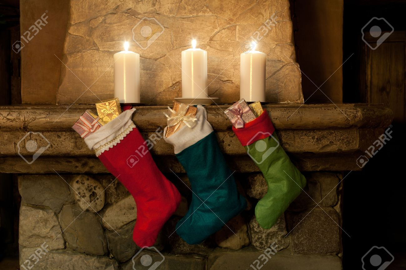 christmas stocking on fireplace background chimney candles