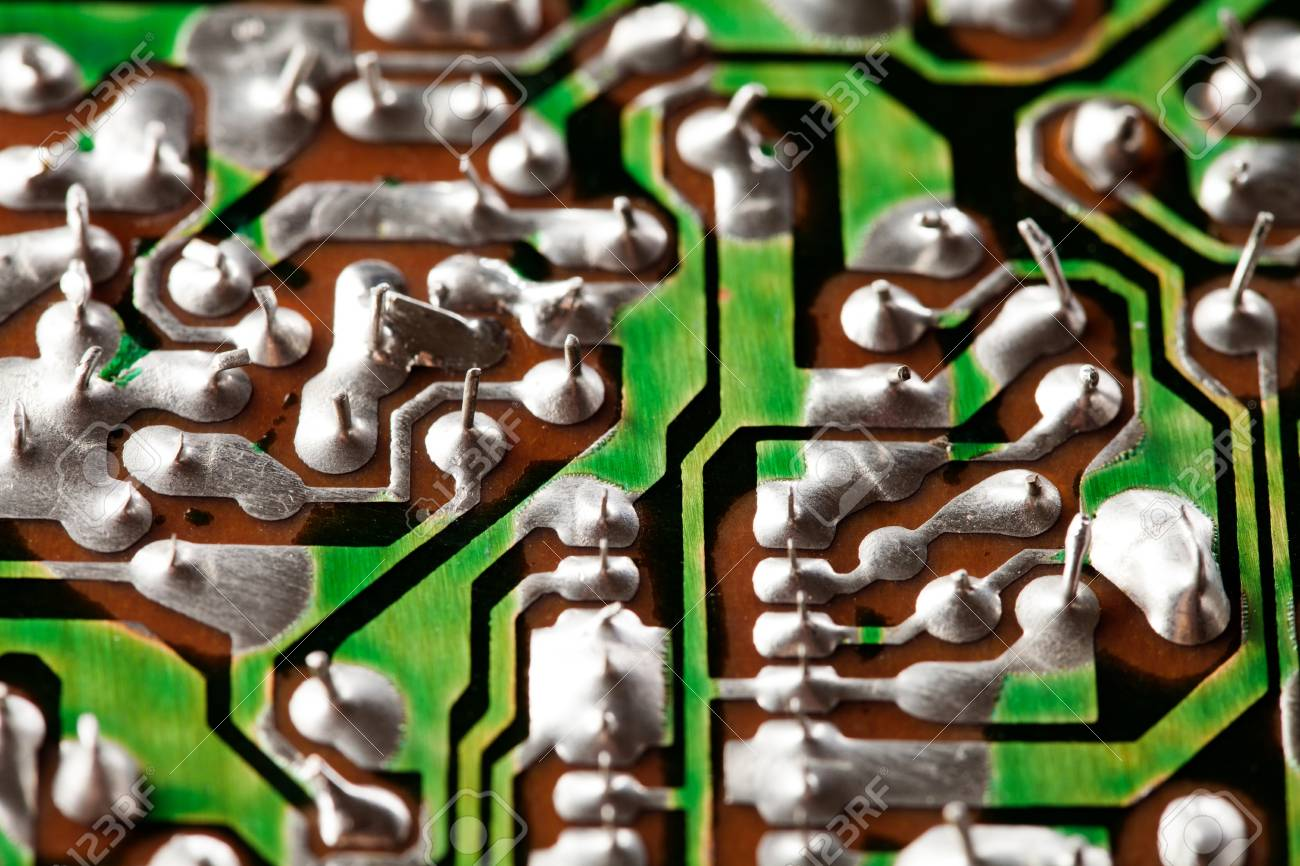 Retro Style Hardware Technology Concept With Green Circuit Board Printed Throughhole Royalty Free Stock Macro View Electronic Chip Soldering Paths