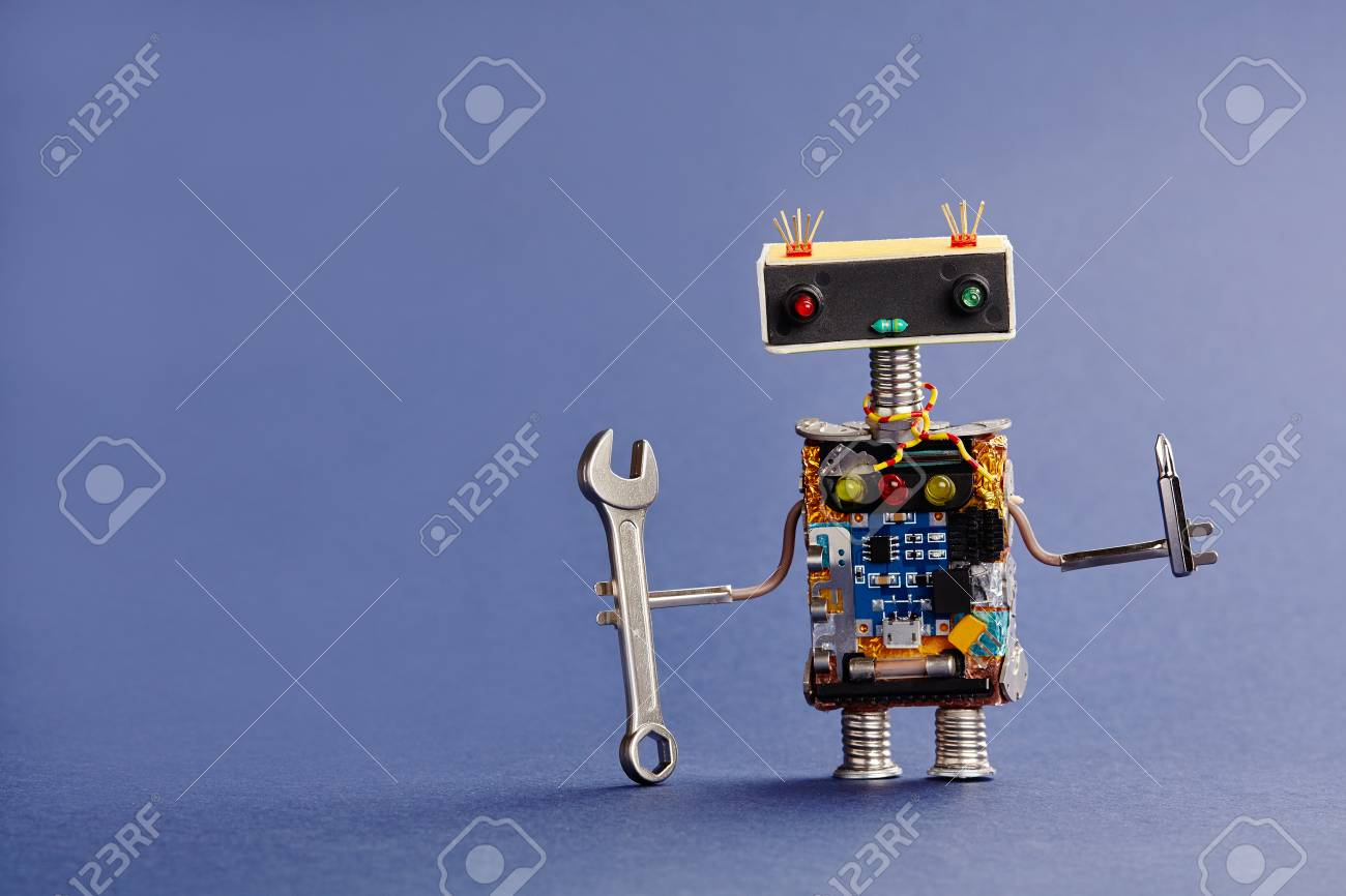 Robot serviceman with hand wrench and screwdriver on blue background. Abstract mechanical toy worker made of electronic circuits, chip capacitors vintage resistors. - 74555742