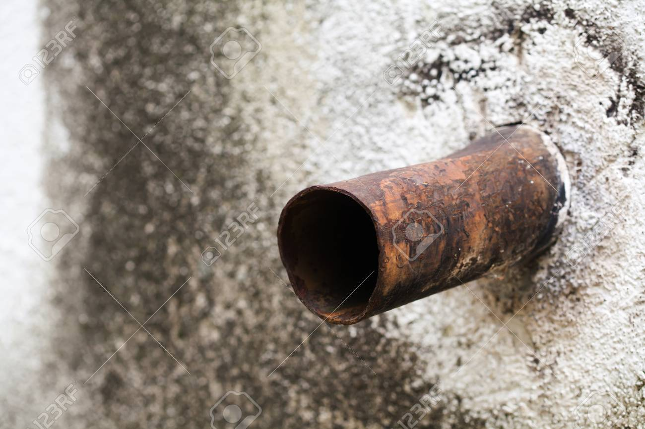 Aged Metallic Overflow Vintage Water Pipe. Stone Wall Background ...