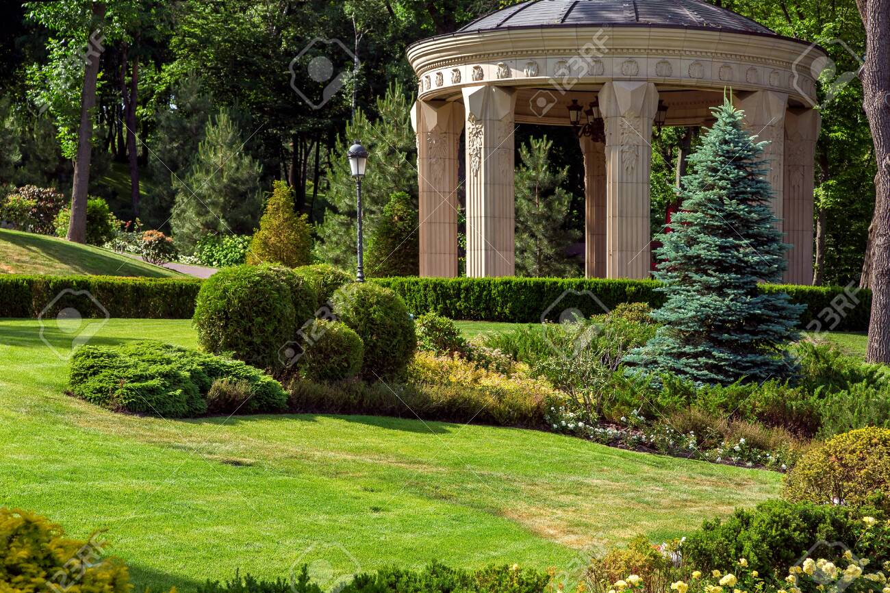 Stone Arbor With Columns In The Park With Landscape Design And