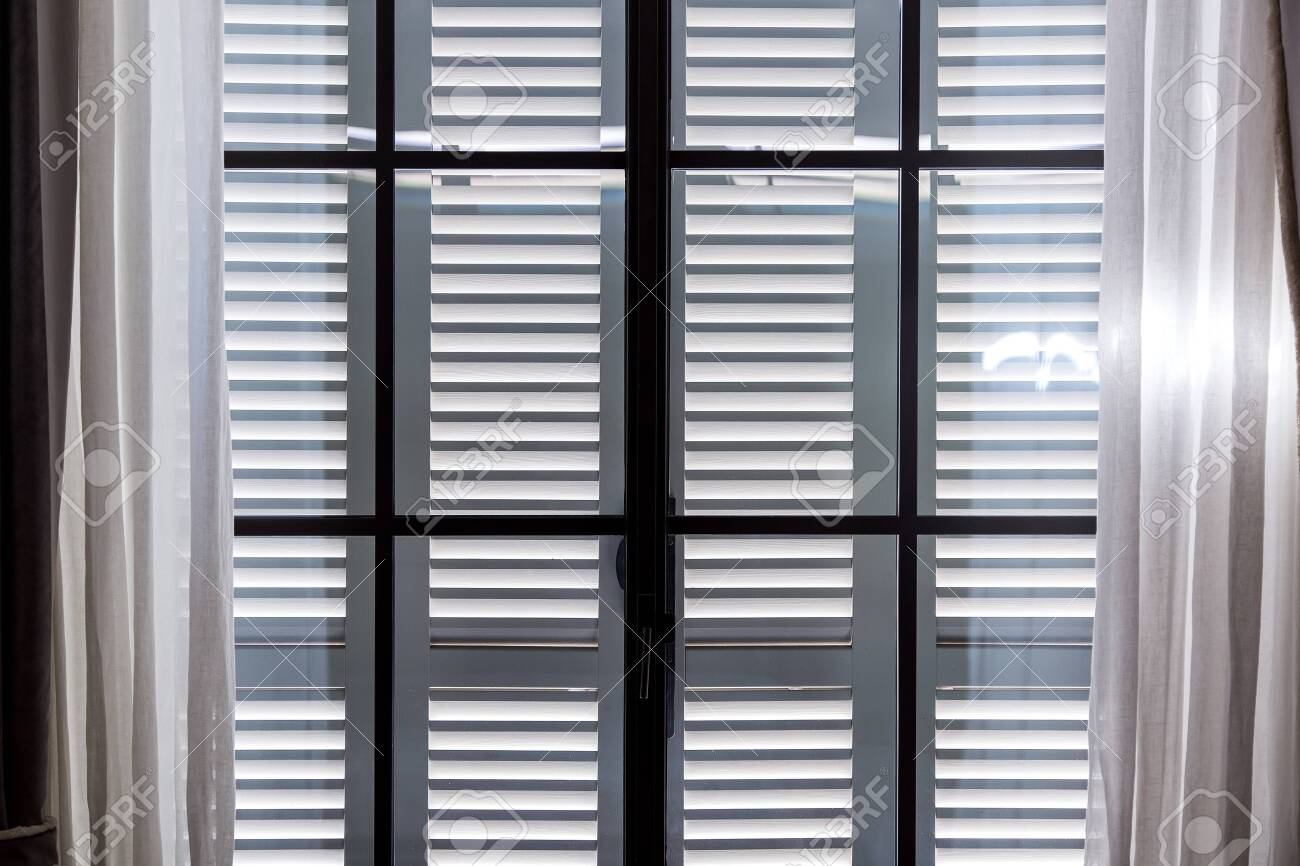 Gray Wooden Window Shutters Protect The Room From Excessive Sunlight