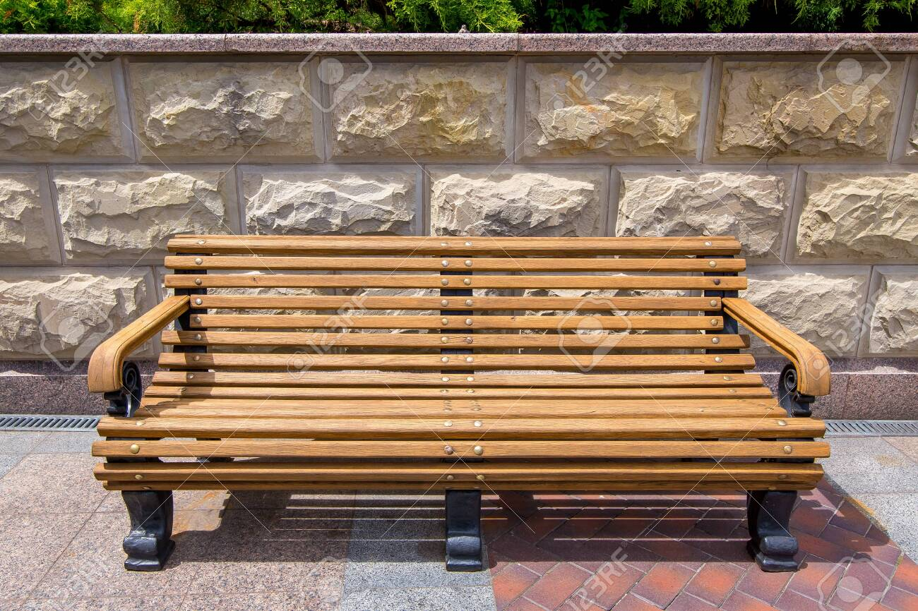 Pleasing Wooden Bench With Iron Legs On The Tile And On The Stone Wall Uwap Interior Chair Design Uwaporg