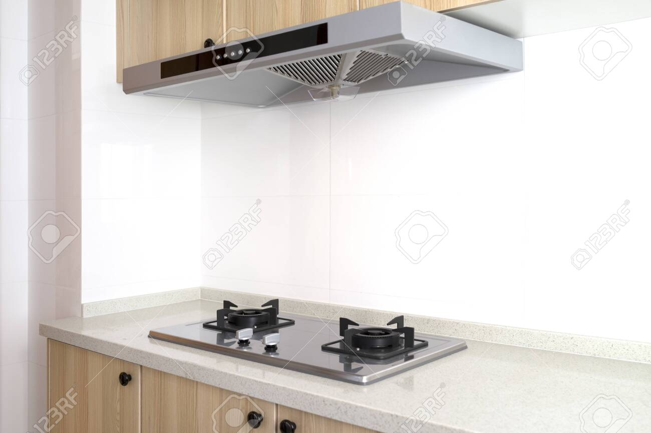 Cooking gas stove with hood in modern kitchen, pantry. top and..