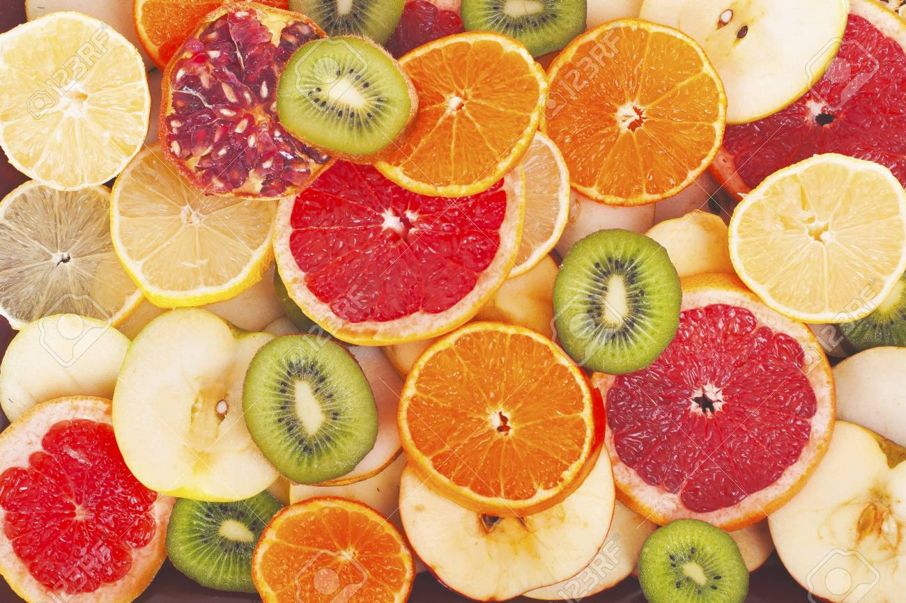 Kiwi orange grapefruit lemon apple pear pomegranate mandarin fruits as background cover wallpaper