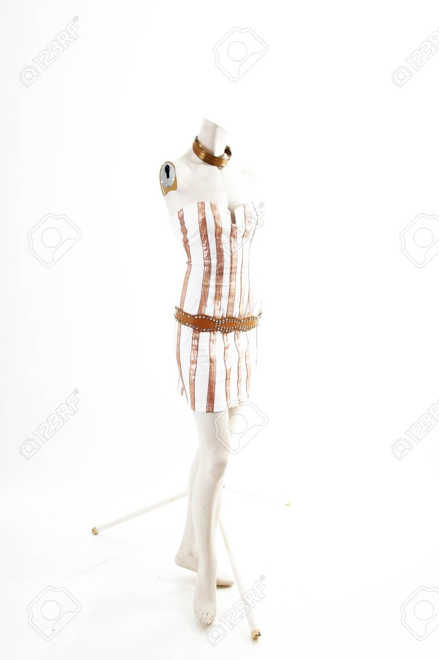 29fa86ed373 Gold white mini dress cocktail wear on mannequin full body shop display.  Woman fashion styles