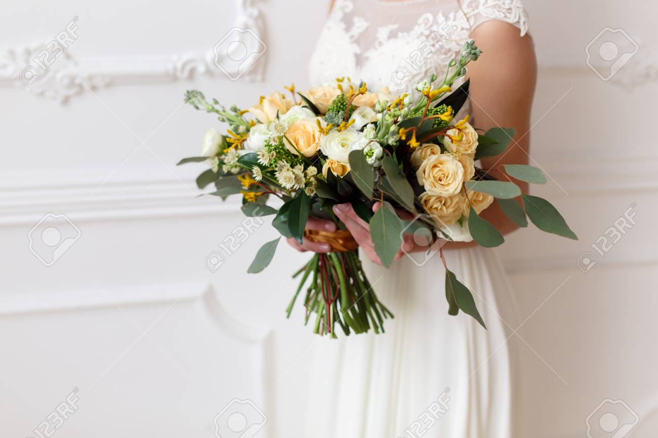 Bride Holding A Bouquet Of Flowers In A Rustic Style Wedding