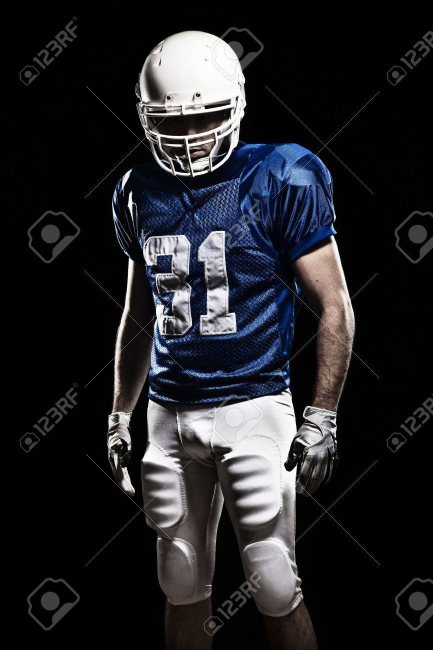 Football Player with number on a blue uniform Studio shot - 19620416