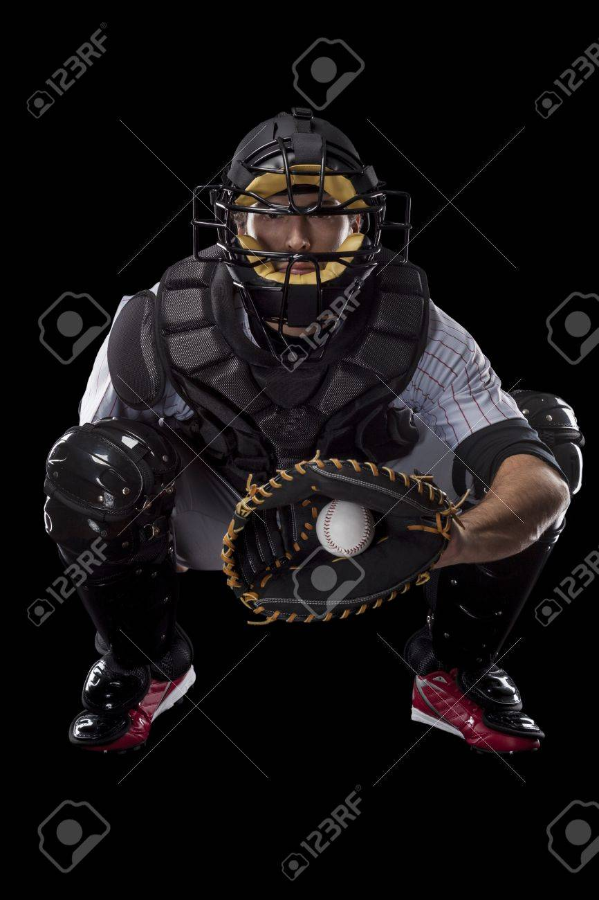 Baseball Player, catcher catching a ball, on a black background. Studio Shot. - 19899972