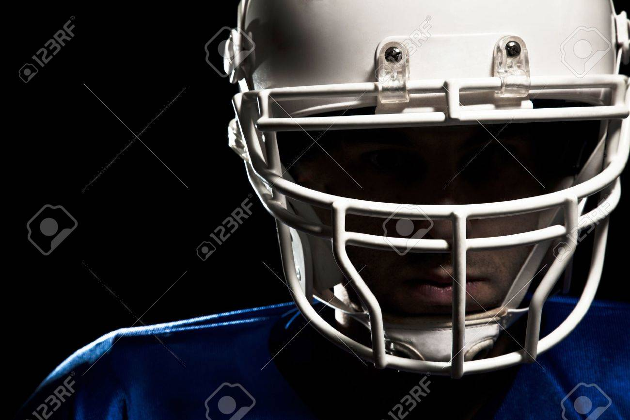 Football Player with number on a blue uniform and a ball in the hand Studio shot - 19905386