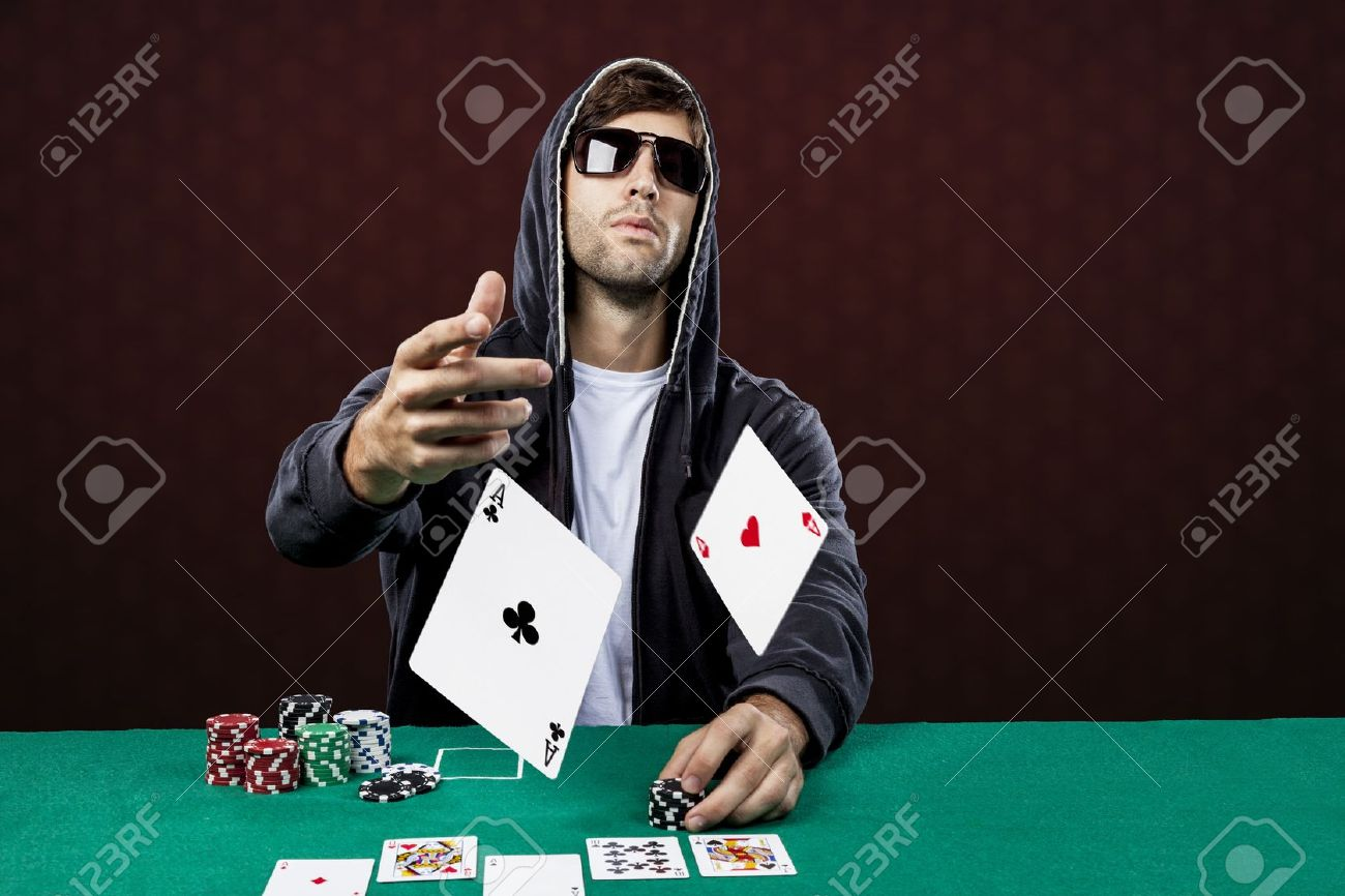 Poker player, on a red background, throwing two ace cards. - 19900035