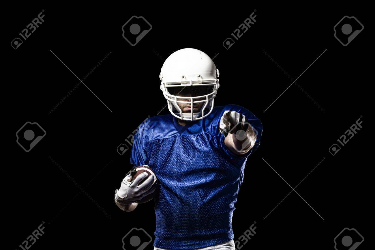Football Player with a blue uniform celebrating on a Black background. - 21782193