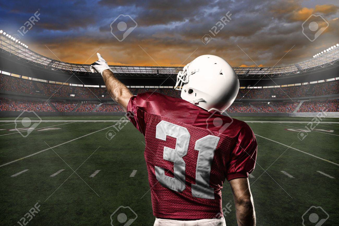 Football Player with a Red uniform celebrating with the fans. - 21782248