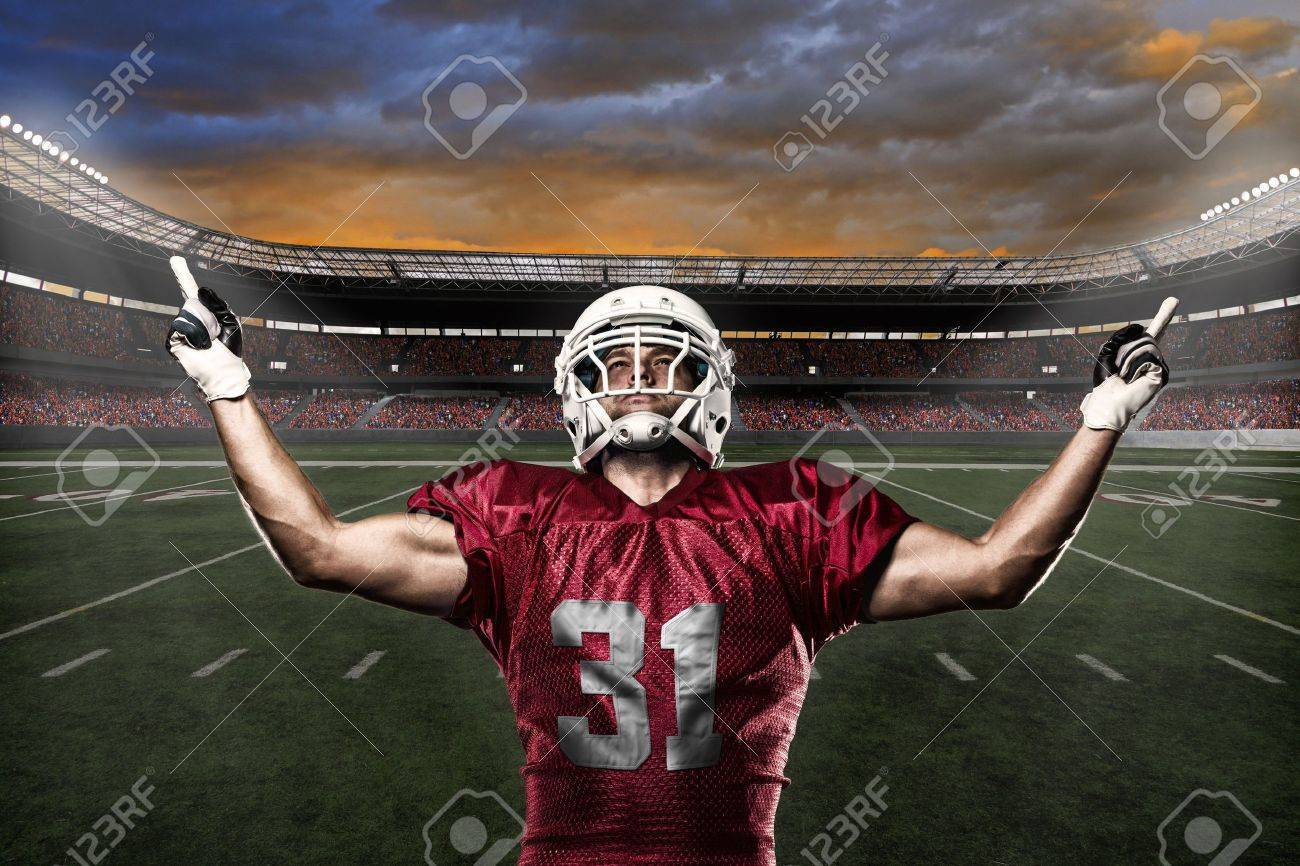 Football Player with a Red uniform celebrating with the fans. - 21782278