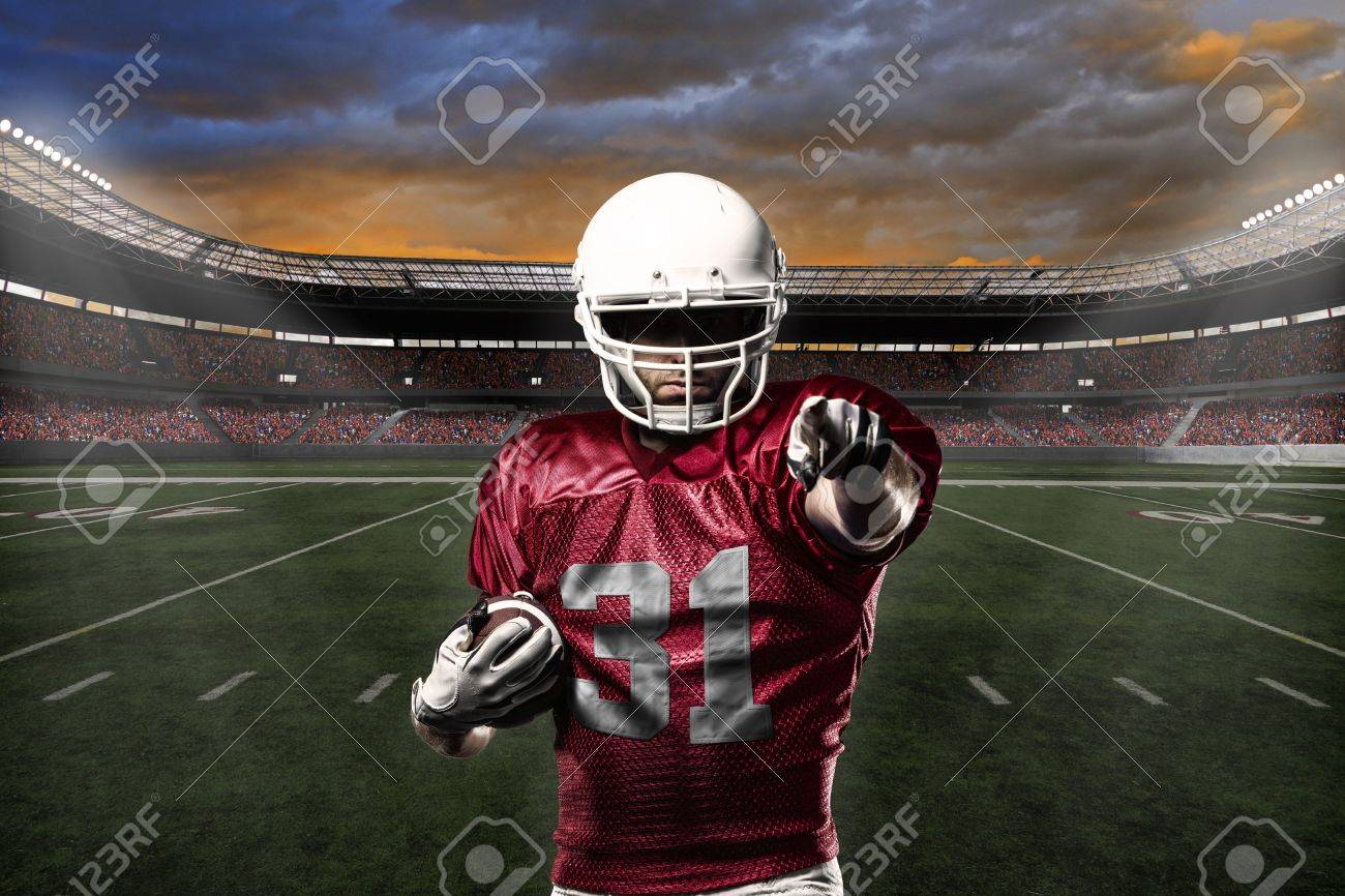 Football Player with a Red uniform celebrating with the fans. - 24352287