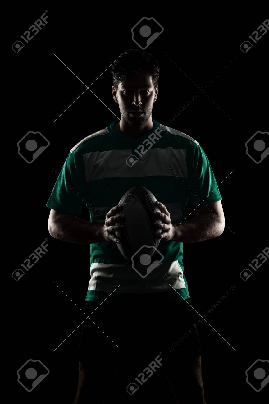 Rugby player in a green uniform - 24417746