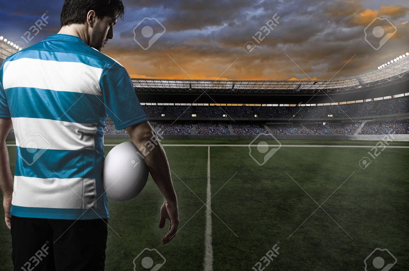 Rugby player in a blue uniform - 24417894