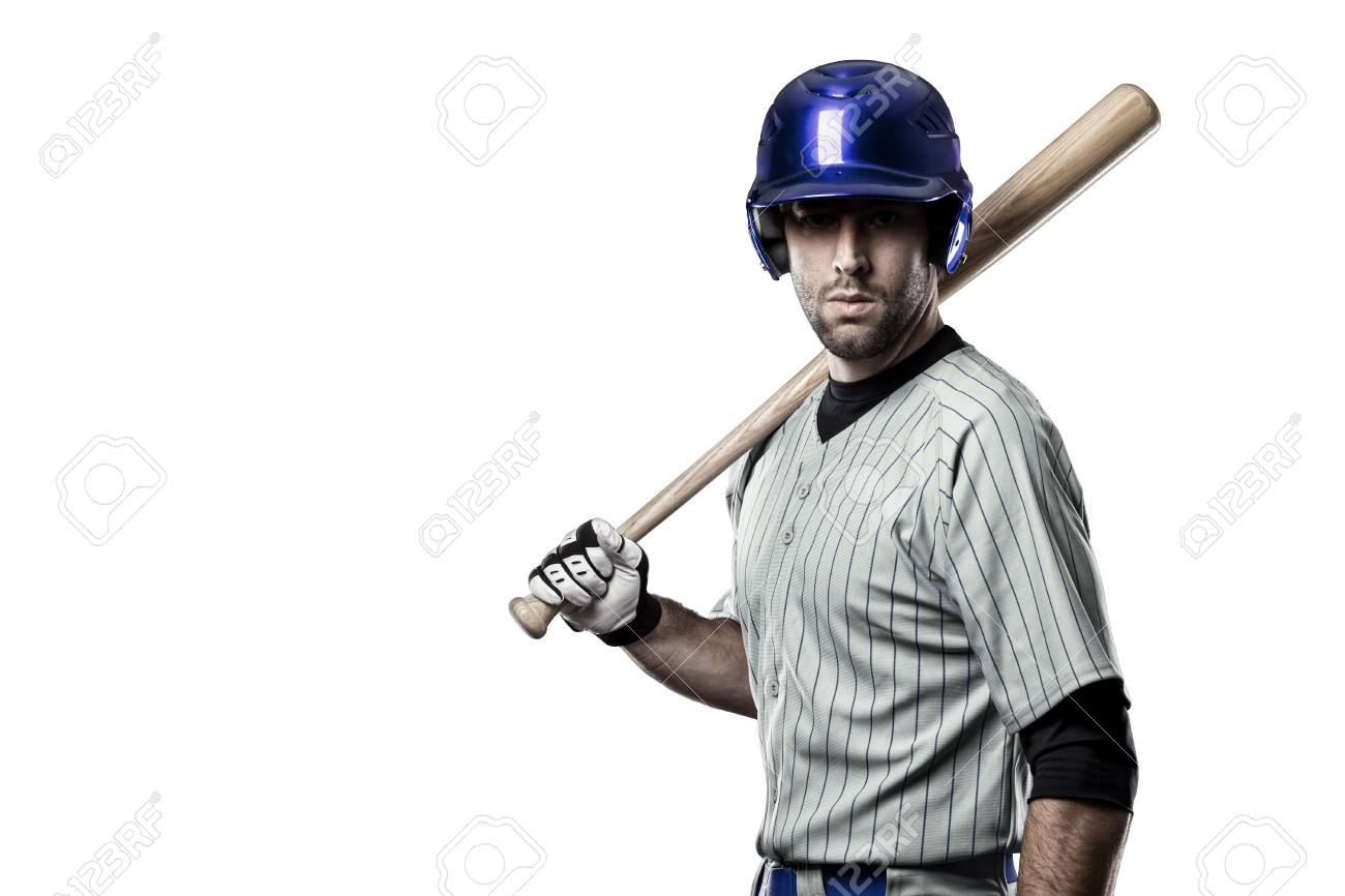 Baseball Player in a blue uniform, on a white background. - 27528616