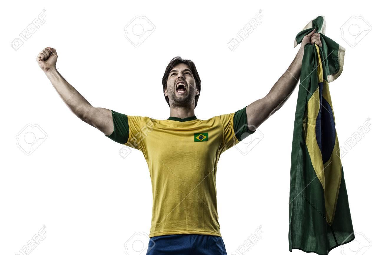 Brazilian soccer player, celebrating on a white background. - 27695778