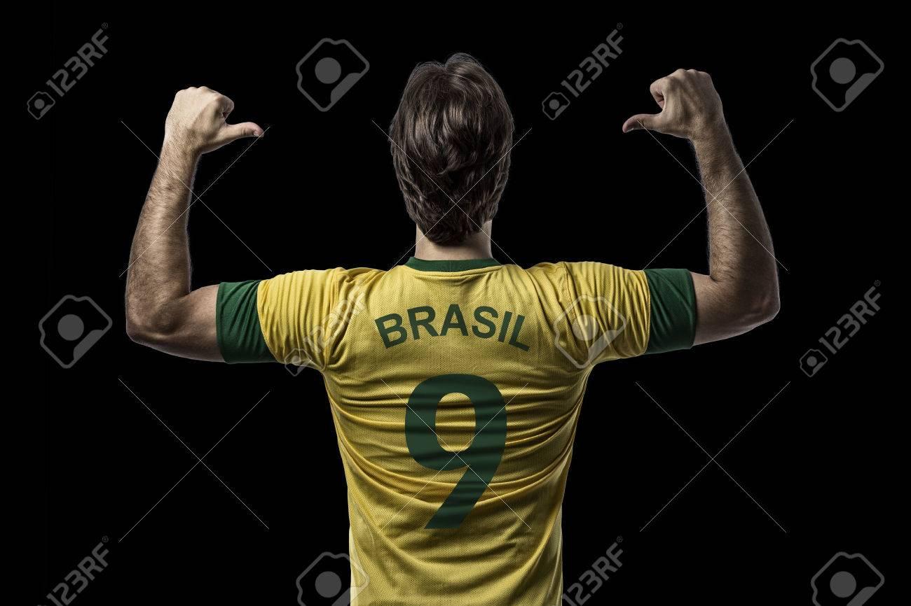 Brazilian soccer player, celebrating on a Black background. - 27695790