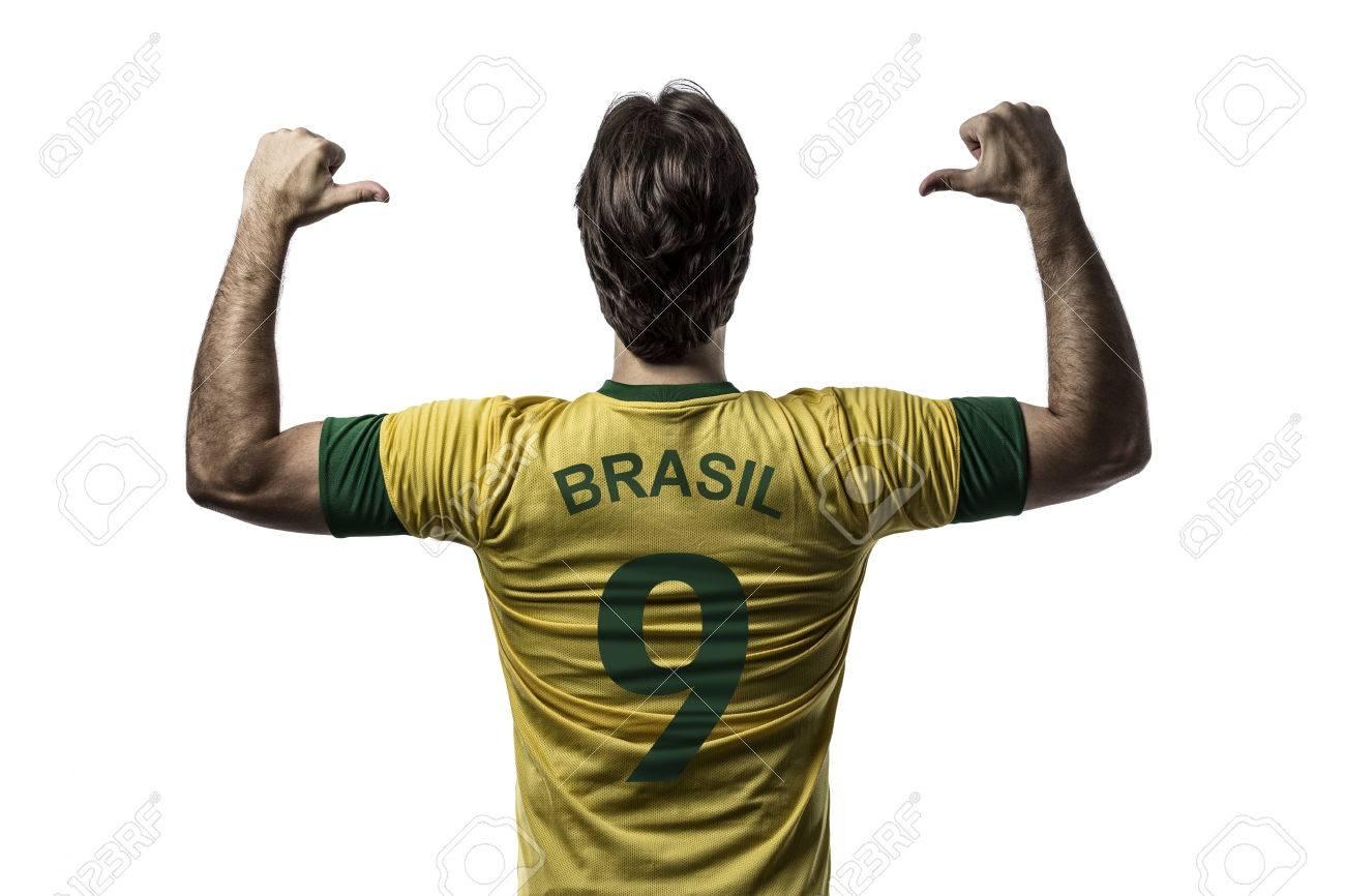Brazilian soccer player, celebrating on a white background. - 27726732