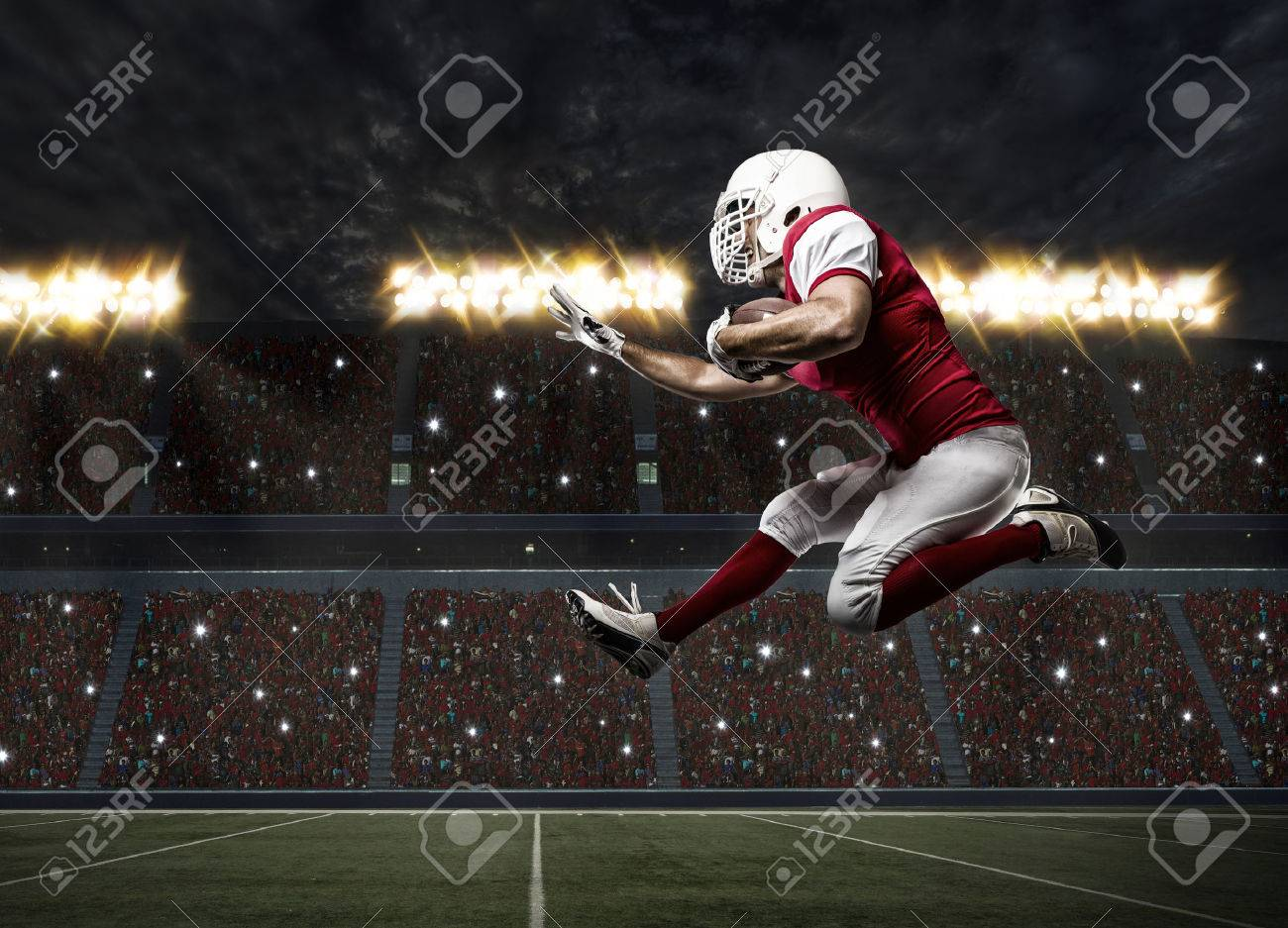Football Player with a red uniform Running on a stadium. - 35218328