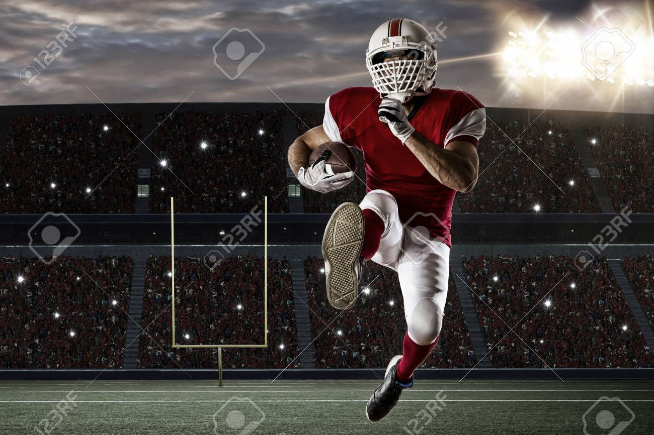 Football Player with a red uniform Running on a Stadium. - 35218423