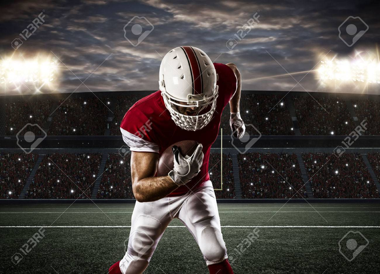 Football Player with a red uniform Running on a Stadium. - 35218425
