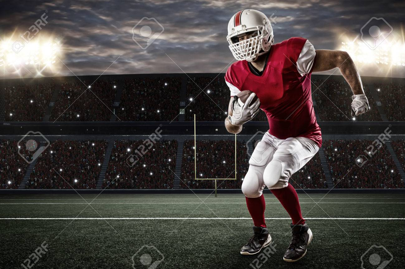 Football Player with a red uniform Running on a Stadium. - 35219396