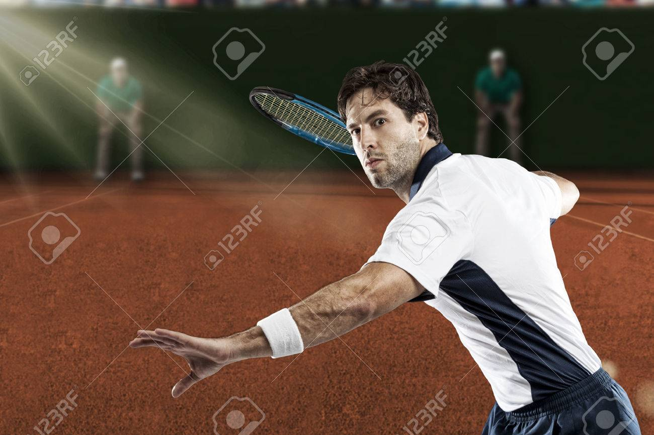 Tennis player playing on a clay tennis court. - 40347920