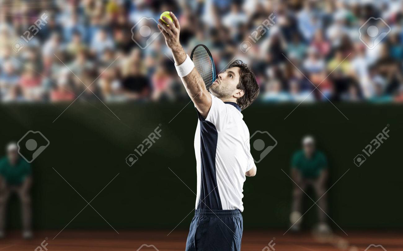 Tennis player playing on a clay tennis court. - 40347923