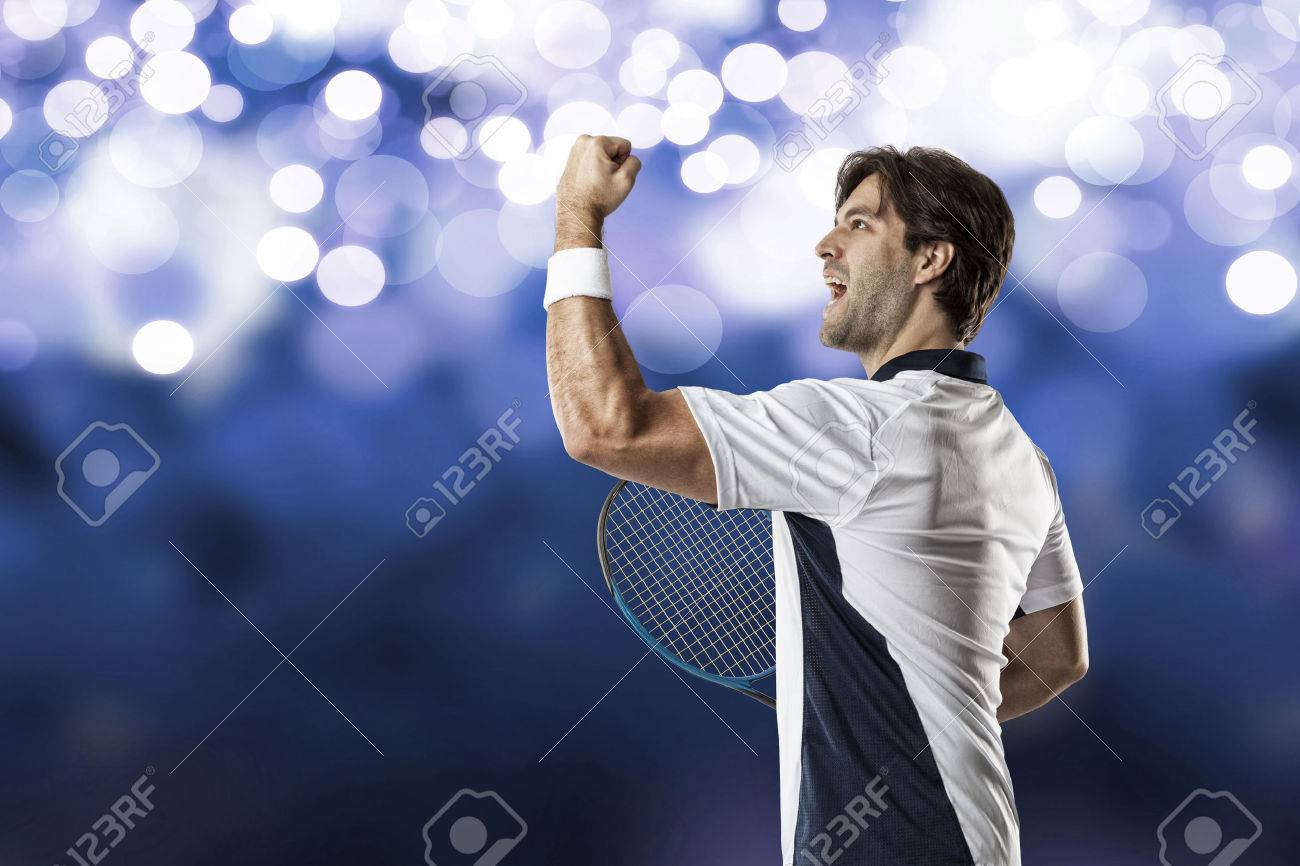 Tennis player celebrating, on a blue lights background. - 40606092