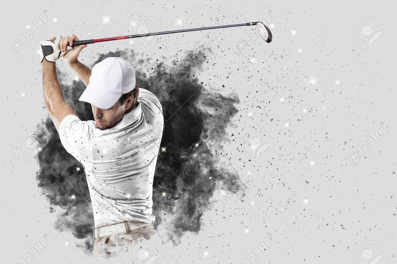 Golf Player with a white uniform coming out of a blast of smoke . - 83022901