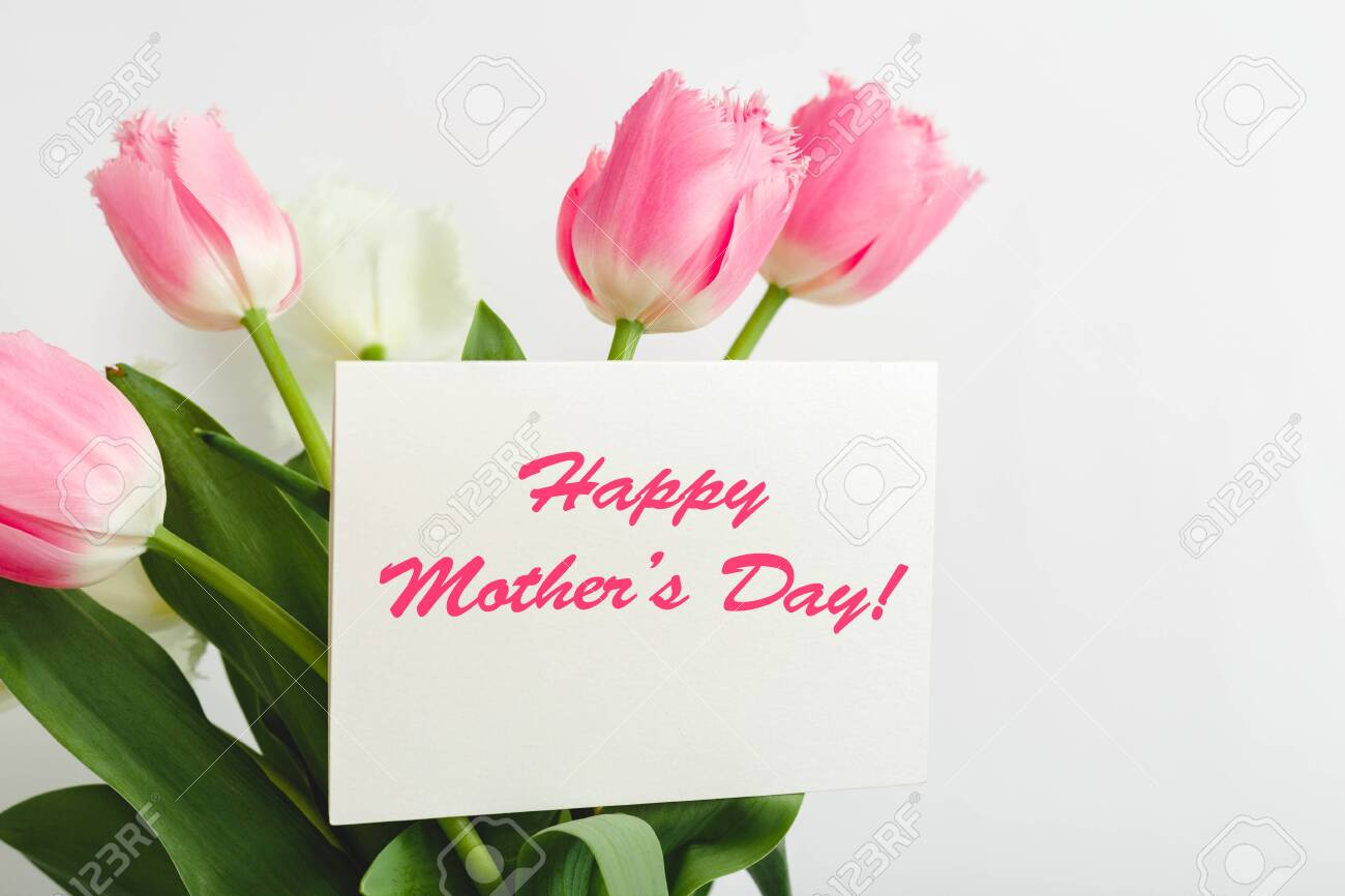 Happy Mothers Day Text On Gift Card In Flower Bouquet On White Stock Photo Picture And Royalty Free Image Image 143738996