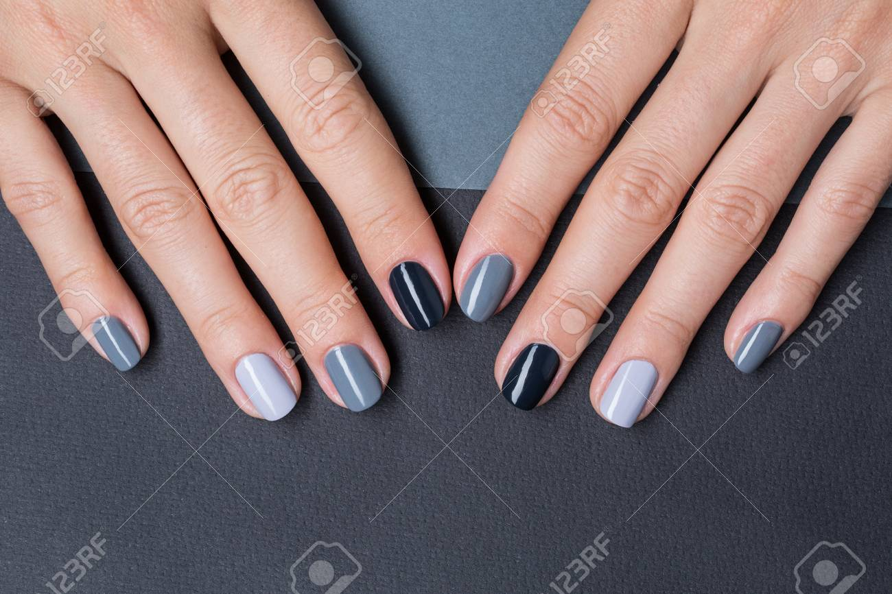 Delicate Female Hands With A Stylish Neutral Manicure. Nail Painted ...