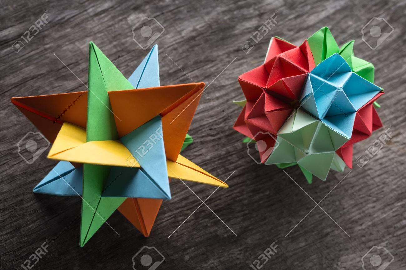 Star and flower kusudama origami on the textured surface star star and flower kusudama origami on the textured surface star origami colored in green jeuxipadfo Gallery