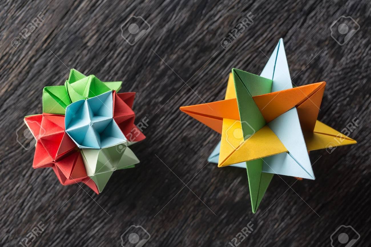 Flower and star kusudama origami on the textured surface star flower and star kusudama origami on the textured surface star origami colored in green mightylinksfo