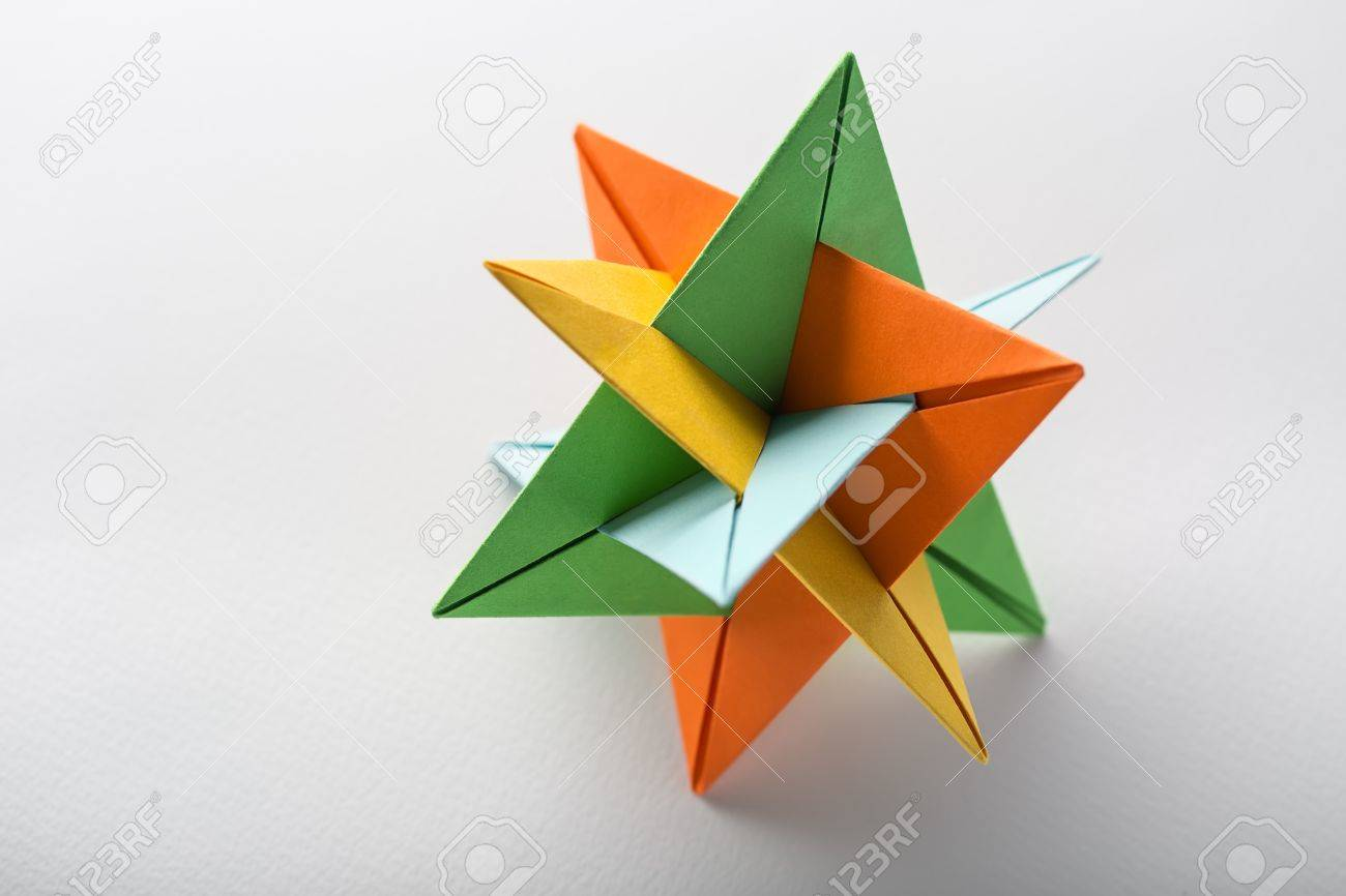 One star kusudama origami on the light background it colored one star kusudama origami on the light background it colored in orange yellow jeuxipadfo Gallery