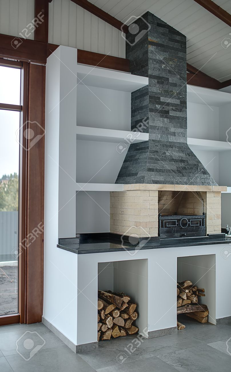 Light Room With Brick Fireplace With Gray Brick Chimney In The
